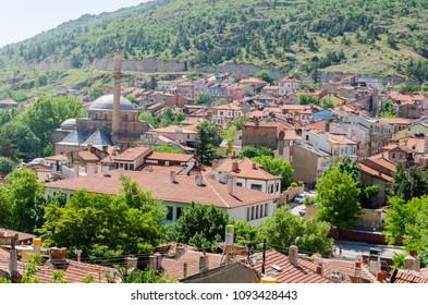 With houses with wooden shutters in the classic Turkish Ottoman style and mosque,  top view. Afyonkarahisar in Turkey,