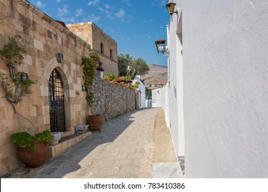 House/villa with flowers on the way to Acropolis of Lindos (Rhodes, Greece)