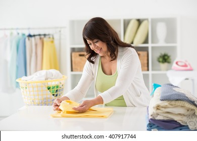 Housewife checking lable before ironing clothes