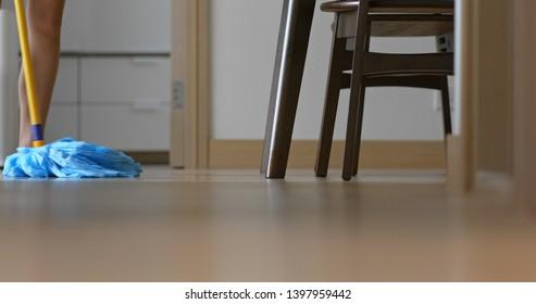 Housewife clean floor with mop