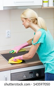 Housewife cleaning in the kitchen.