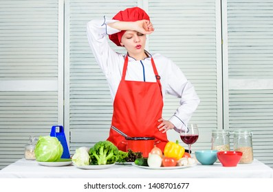Housewife cooking and drink wine. Enjoy easy ideas for dinner. Woman enjoy cooking food. Housekeeping and culinary. Housewife prepare meal with wine. Housewife daily routine. Girl adorable chef.
