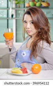 Housewife eating diet food as fruit and juice for healthy