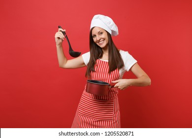 Housewife female chef cook or baker in striped apron white t-shirt toque chefs hat isolated on red wall background. Woman hold tasting empty stewpan black soup ladle dipper Mock up copy space concept