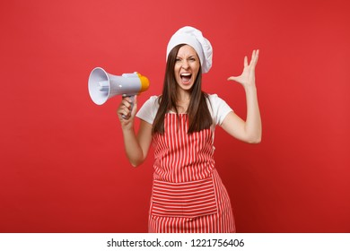Housewife female chef cook or baker in striped apron t-shirt toque chefs hat isolated on red wall background. Shocked woman scream in megaphone, announces discounts sale. Mock up copy space concept