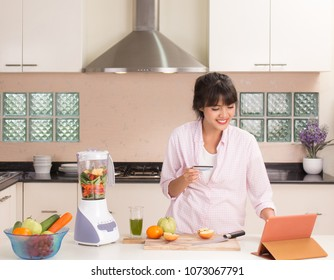 Housewife in the kitchen and ordering stuff online store for cooking