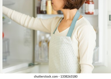Housewife looking through the refrigerator