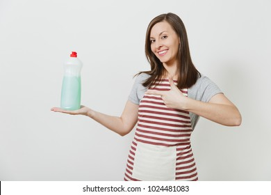 Housewife in striped apron looking camera isolated on white background Housekeeper woman pointing index finger aside on bottle with dishwashing cleaner liquid Bottle with copy space for advertisement