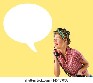 Housewife talking on the phone,yellow background