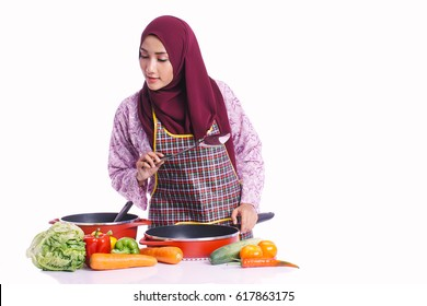 Housewife wear an apron ready to cook for family members with different body expression and body language isolated on white background - kitchen, food, cooking and lifestyle concept