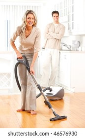 Housework, vacuum cleaner, young couple, home, kitchen