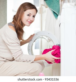 Housework: young woman doing laundry (shallow DOF; color toned image)