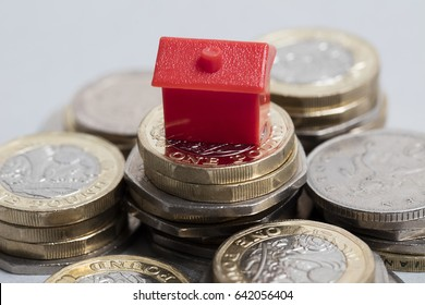 Housing cost. Red house with British currency