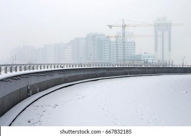 Housing development. Construction site in winter fog. Minsk, Belarus.