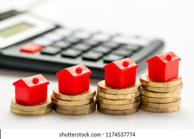 Housing estate concept with coins in studio