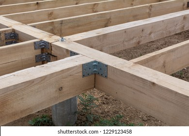 Housing frame assembly. Installation of residential building base of a-type frame house.
