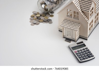 Housing loan concept-Coins, house and calculator