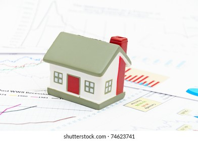 Housing market concept image with graph on chart background