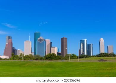 Houston skyline blue sky and Memorial park turf at Texas USA US