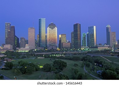Houston skyline with Memorial Park in foreground at dusk in Texas