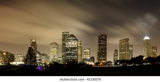 Houston Skyline at night with beautifully lighted clouds