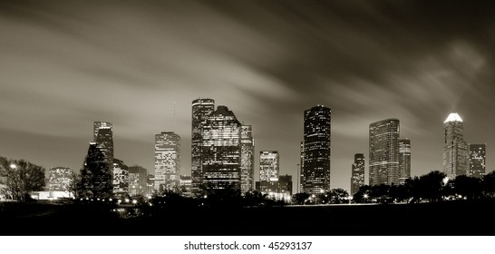 Houston Skyline at night with beautifully lighted clouds in Monochrome