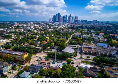 Houston , Texas aerial drone view above homes and the surrounding area of Houston Texas with downtown skyline cityscape in the background