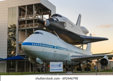HOUSTON, TEXAS - APRIL 14, 2017  The space shuttle at Independence Plaza in Space Center Houston at sunset, Texas.