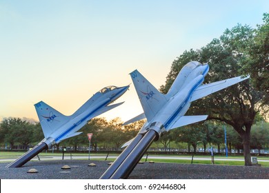 HOUSTON, TEXAS - APRIL 14, 2017  Two jets on display at Independence Plaza in Space Center Houston at sunset, Texas.