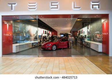 HOUSTON, TEXAS - AUG 27, 2016: Entrance to Tesla showroom with Model S 2016 in Galleria shopping center. Tesla Motors, Inc. is an American public company designs, manufactures, and sells electric cars