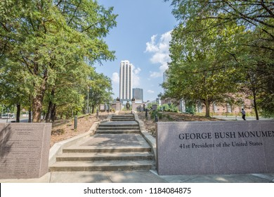 HOUSTON, TEXAS, August 2018: George H.W. Bush monument in Sesquicentennial Park looking towards the Downtown Houston skyline