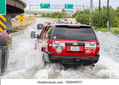 Houston, Texas - August 27, 2017: Houston emergency services with cars across the flooded street in Houston, Texas, USA. Heavy rains from hurricane Harvey caused many flooded areas in Houston.