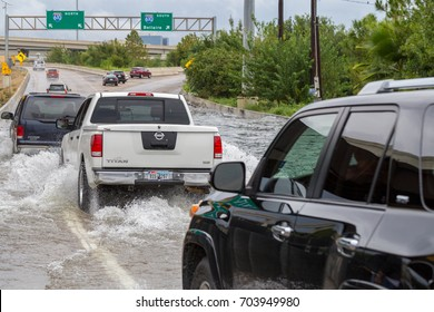 Houston, Texas - August 27, 2017: Houston residents with cars across the flooded street in Houston, Texas, USA. Heavy rains from hurricane Harvey caused many flooded areas in Houston.