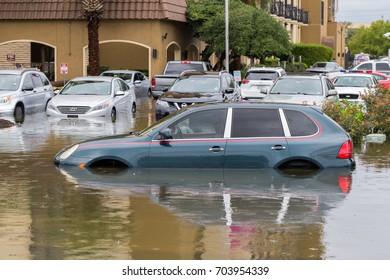 Houston, Texas - August 27, 2017: Cars submerged from hurricane Harvey in Houston, Texas, USA. Heavy rains from hurricane Harvey caused many flooded areas in Houston.