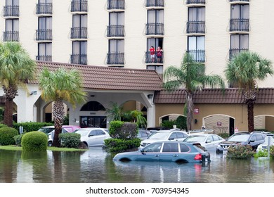 Houston, Texas - August 27, 2017: Cars submerged near hotel from hurricane Harvey in Houston, Texas, USA. Heavy rains from hurricane Harvey caused many flooded areas in Houston.