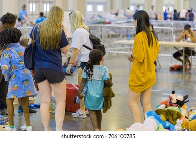 Houston, Texas, August 30, 2017: Another shelter opens at NRG Center as refugees seek safety in Houston. Support workers and volunteers in children play area