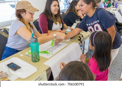Houston, Texas, August 30, 2017: Another shelter opens at NRG Center as refugees seek safety in Houston. Trained support workers check in new flood evacuees