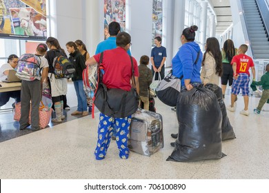 Houston, Texas, August 30, 2017: Another shelter opens at NRG Center as refugees seek safety in Houston. New evacuees waiting to check in