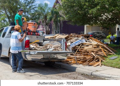 Houston, Texas - August 31, 2017: Cleanup begins in Houston after hurricane Harvey and heavy floods. Local business assists resident in their cleanup efforts