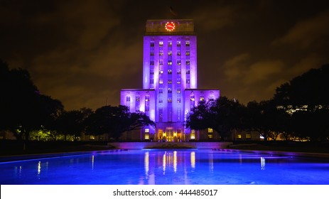 Houston, Texas City Hall building lit up at night with reflecting pool