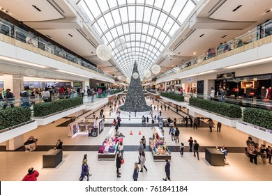 Houston, Texas - December 23, 2016: People Busy Christmas Holiday Shopping in the Galleria Shopping Mall, Giant Christmas Tree and Skate Rink are visible in the distance