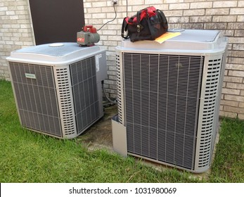 Houston, Texas - July 9 2014: Air conditioning repair and new installation with tool bag
