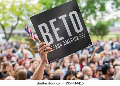Houston, Texas - March 30, 2019: Supporter holds banner BETO FOR AMERICA during Beto O'Rourke campaign rally in Houston