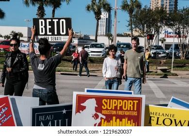 Houston, Texas - November 2, 2018: A Volunteer Holding Beto For Senate Sign Outside Voting Station in Texas