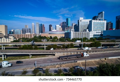 Houston Texas truck entering on the massive transportation highway system in downtown Houston , TX