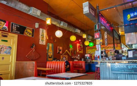 Houston, Texas, United States of America - December 27, 2016. Interior view of Tacos A Go Go tex-mex restaurant in Houston, with people and furniture.