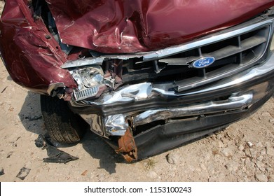 Houston, Texas USA - August 2 2011: Wrecked Ford F150 showing external damage wrecked bumper and twisted frame