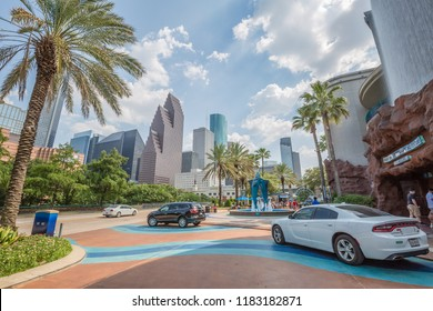 HOUSTON, TEXAS, USA - august, 2018: tourists on the cars drive up to entrance of the Downtown Aquarium near fountain with a swordfish sculpture at   in Houston.