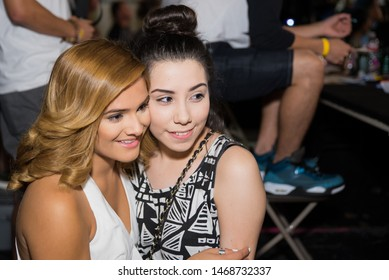 """Houston, Texas / USA - August 23, 2014: Dancer and Houston Native Olivia Irene """"Chachi"""" Gonzales (Right) Taking a Portrait with a Fan"""