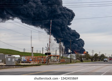 HOUSTON, TEXAS, USA - MARCH 18, 2019: Flames coming from burning tanks after fire accident at petrochemical plant Intercontinental Terminals Company near Deer Park